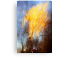 Abstract defocused colour lights in a dark blue night sky Canvas Print