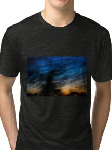 Motion blurred trees and landscape abstract at sunset  Tri-blend T-Shirt