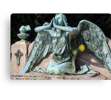 weeping angel at the Monumental Cemetery of Staglieno (Cimitero monumentale di Staglieno), Genoa, Italy Canvas Print