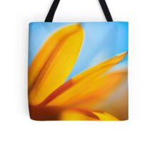 Extreme close up of a yellow daisy with a blue sky background  Tote Bag