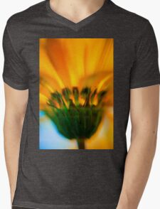 Extreme close up of a yellow daisy with a blue sky background  Mens V-Neck T-Shirt