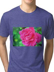 Pink rose on green natural background. Tri-blend T-Shirt