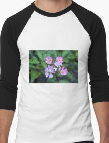 Small purple flowers on green leaves background. Men's Baseball ¾ T-Shirt