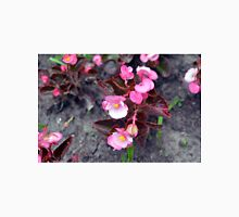 Beautiful fragile pink flowers on the ground. Unisex T-Shirt