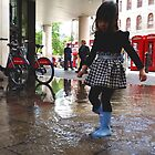 Playing in Puddles in the City by Vanessa  Warren