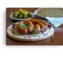 Sausage in dish Canvas Print