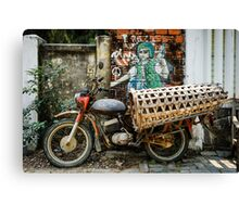Vietnamese pig carrier against a peaceful sign Canvas Print