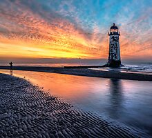 Lighthouse Sunset by Adrian Evans