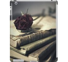 Still life with books and dry red rose iPad Case/Skin