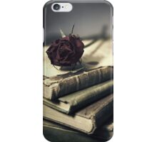 Still life with books and dry red rose iPhone Case/Skin