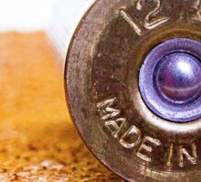 Close up of a 12ga shotgun shell with shallow DOF. Sticker