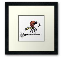 Snoopy riding a broom Framed Print