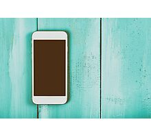 White Mobile Phone With Blank Screen On Wood Table Photographic Print