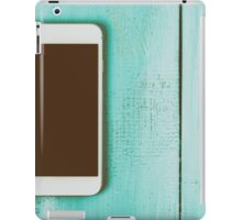 White Mobile Phone With Blank Screen On Wood Table iPad Case/Skin