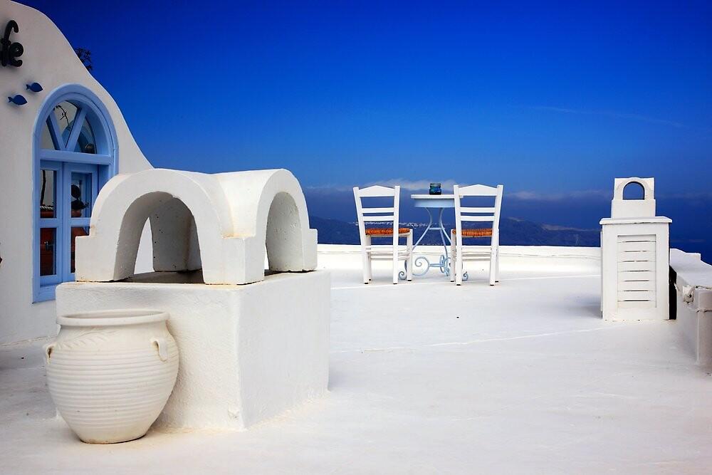Have a seat at Firostefani - Santorini island by Hercules Milas