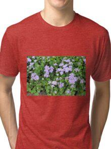 Purple flowers, natural background  Tri-blend T-Shirt