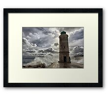 Lighthouse in the storm Framed Print