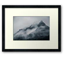 Peaks of hills are sticking out from foggy  Framed Print