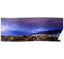 Lightning storm over city in purple light Poster