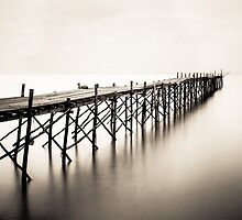 Wooden beach pier with color filter effect by Stanciuc