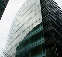 Glass building with reflections by Clayton Suares