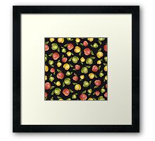 Apples on a black background Framed Print