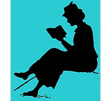 Reading outdoors: late Victorian - era silhouette of woman with book Photographic Print