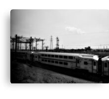 On a train, passing another. Canvas Print