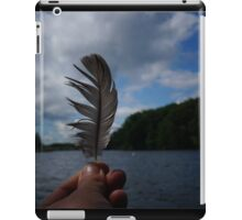 Holding Up a Feather at the Lake iPad Case/Skin