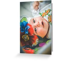 Newborn child relaxing in bed. Greeting Card