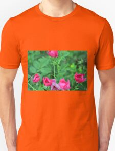 Beautiful delicate pink roses on green leaves background. Unisex T-Shirt