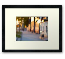 Out of focus image of streets and buildings Framed Print
