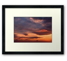 Sunset sky with orange clouds. Framed Print