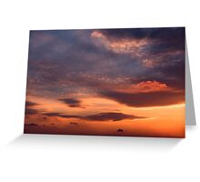 Sunset sky with orange clouds. Greeting Card