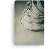 Four teacups and the small plate on the table Canvas Print
