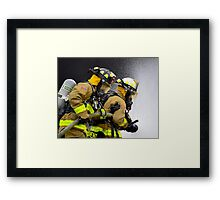 Firefighters in action Framed Print