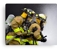 Firefighters in action Canvas Print