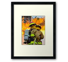 firefighters battle a wildfire Framed Print