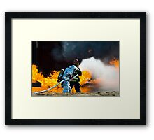 firefighters spray water to wildfire Framed Print