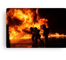 Firefighter bracing during firefighting Canvas Print