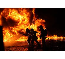Firefighter bracing during firefighting Photographic Print
