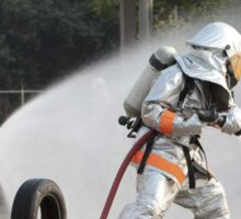 Firefighters hosing down fire Sticker