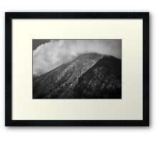 Clouds chasing over a mountain, Austria Framed Print