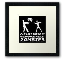 CATS ARE THE BEST WEAPON AGAINST ZOMBIES Framed Print