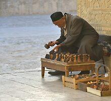 Stamp Seller - Bukhara, Uzbekistan by Kasia Nowak