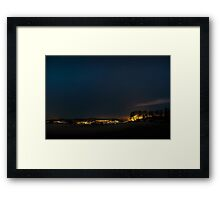 The local town turns the light on Framed Print