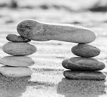 A stack of pebbles in black and white, arch shape, zen concept by Stanciuc