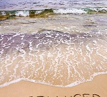 Word FREELANCER written in sand, on a beautiful beach by Stanciuc