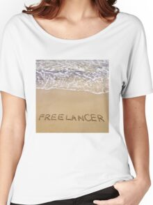 Word FREELANCER written in sand, on a beautiful beach Women's Relaxed Fit T-Shirt