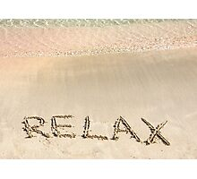 Relax word written in the sand, on a beautiful beach with clear blue waves in background Photographic Print